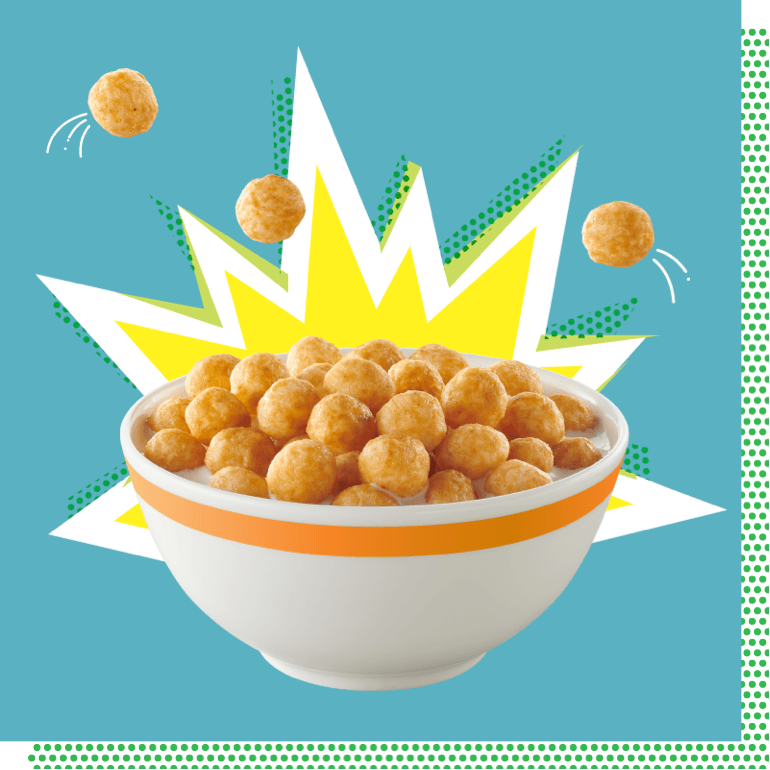 A bowl of Wonderworks Peanut Butter Keto Friendly Cereal with a yellow comic-book style explosion