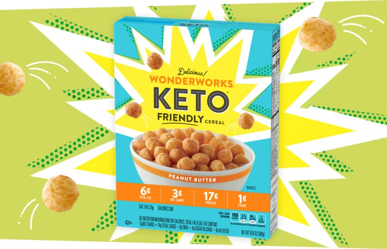 A lime green box of delicious Wonderworks Peanut Butter Keto friendly cereal. Cereal pieces explode from the box.
